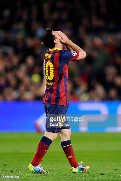 Lionel Messi of Barcelona reacts after his shot on goal hit the post during the UEFA Champions League Round of 16, second leg match between FC...
