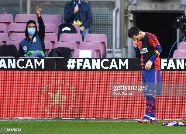 Lionel Messi of Barcelona reacts after scoring their sides fourth goal while wearing a Newell's Old Boys shirt with the number 10 on the back in...