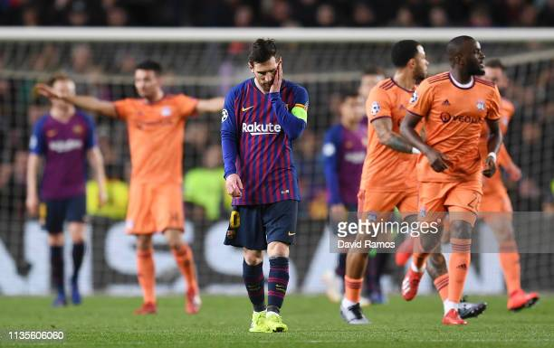 Lionel Messi of Barcelona reacts as Lucas Tousart of Olympique Lyonnais scores his team's first goal during the UEFA Champions League Round of 16...