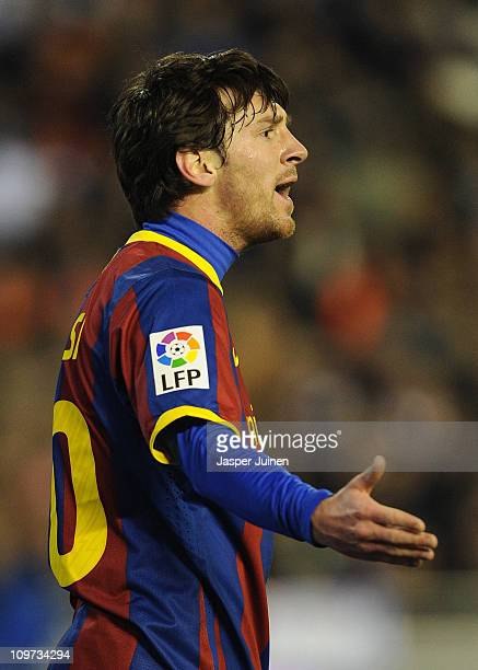 Lionel Messi of Barcelona reacts during the la Liga match between Valencia and Barcelona at Estadio Mestalla on March 2 2011 in Valencia Spain