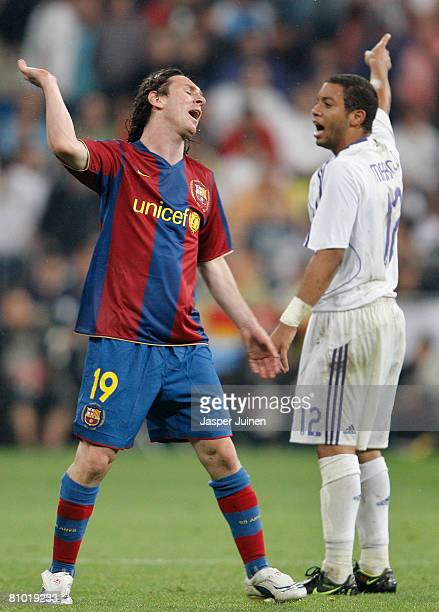 Lionel Messi of Barcelona reacts flanked by Marcelo of Real Madrid during the La Liga match between Real Madrid and Barcelona at the Santiago...