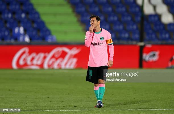 Lionel Messi of Barcelona reacts to Getafe CF scoring their first goal during the La Liga Santander match between Getafe CF and FC Barcelona at...