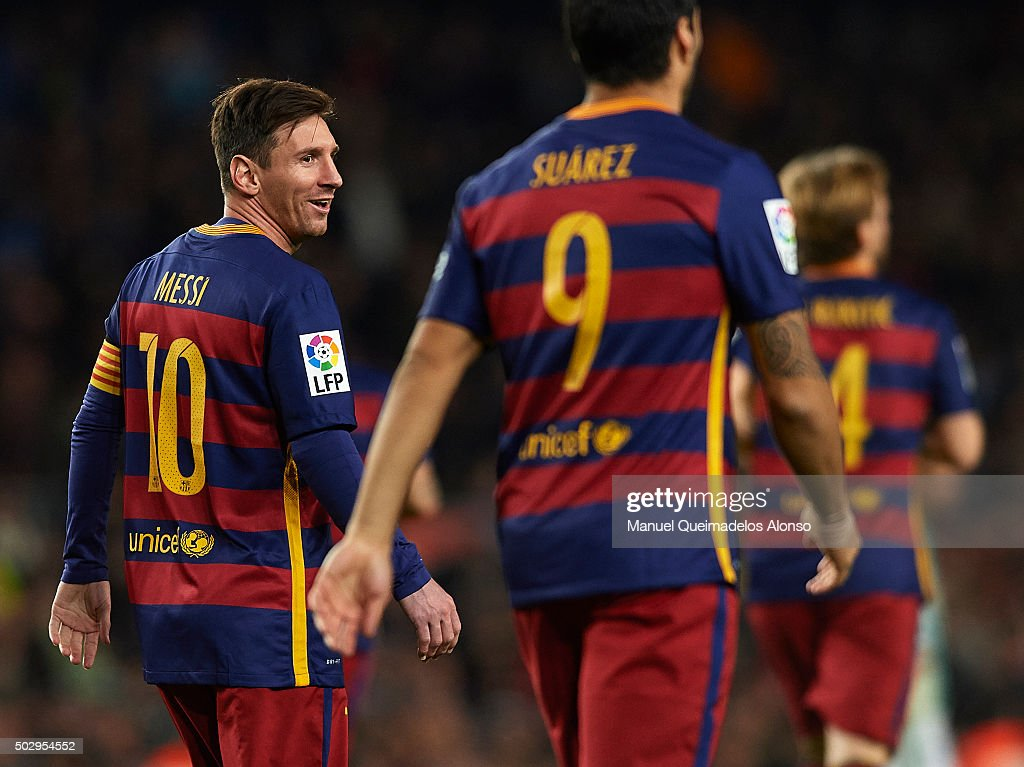Lionel Messi of Barcelona reacts to Luis Suarez during the La Liga match between FC Barcelona and Real Betis Balompie at Camp Nou on December 30, 2015 in Barcelona, Spain.