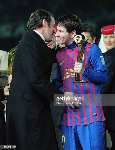 Lionel Messi of Barcelona receives the Adidas Golden Ball Award from Barcelona President Sandro Rosell after the FIFA Club World Cup Final match...