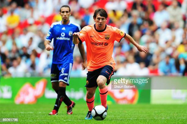 Lionel Messi of Barcelona runs at the Al Ahly defence during the Wembley Cup match between Barcelona and Al Ahly at Wembley Stadium on July 26 2009...