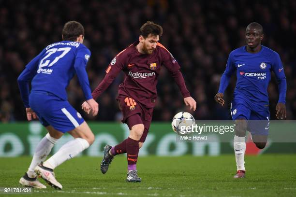 Lionel Messi of Barcelona runs between Andreas Christensen and Ngolo Kante of Chelsea during the UEFA Champions League Round of 16 First Leg match...