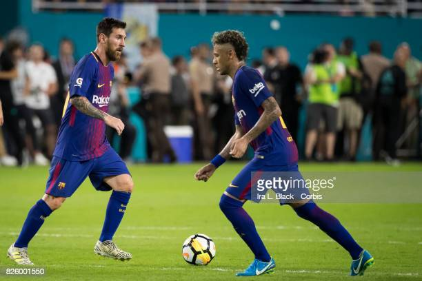 Lionel Messi of Barcelona runs past Neymar of Barcelona with the ball during the International Champions Cup El Clásico match between FC Barcelona...