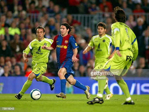 Lionel Messi of Barcelona runs through Getafe players to score during the match between FC Barcelona and Getafe of Copa del Rey on April 18 played at...