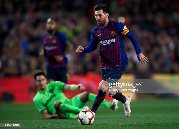 Lionel Messi of Barcelona runs with the ball during the La Liga match between FC Barcelona and Levante UD at Camp Nou on April 27 2019 in Barcelona...