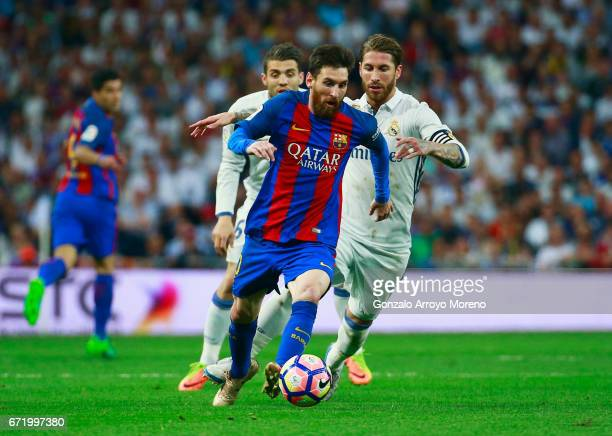Lionel Messi of Barcelona runs with the ball during the La Liga match between Real Madrid CF and FC Barcelona at Estadio Bernabeu on April 23 2017 in...