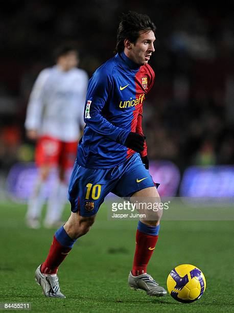 Lionel Messi of Barcelona runs with the ball during the La Liga match between Barcelona and Numancia at the Camp Nou Stadium on January 24, 2009 in...