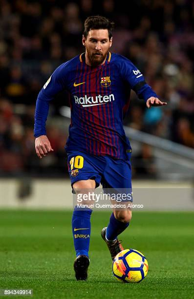 Lionel Messi of Barcelona runs with the ball during the La Liga match between Barcelona and Deportivo de La Coruna at Camp Nou on December 17 2017 in...