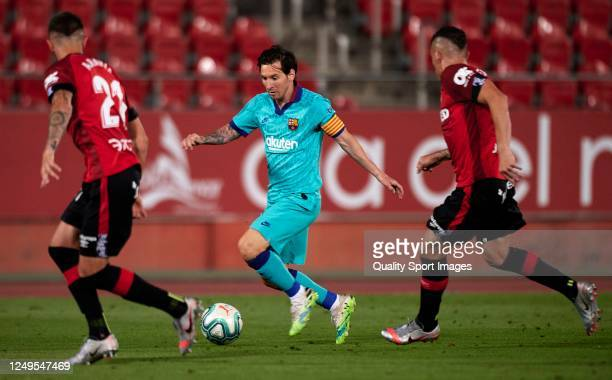 Lionel Messi of Barcelona runs with the ball during the Liga match between RCD Mallorca and FC Barcelona at Iberostar Estadi on June 13, 2020 in...