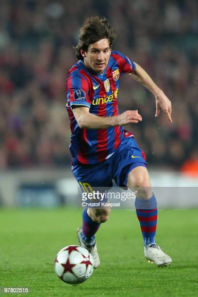 Lionel Messi of Barcelona runs with the ball during the UEFA Champions League round of sixteen second leg match between FC Barcelona and VfB...