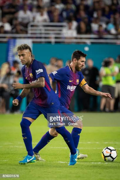 Lionel Messi of Barcelona runs with the ball past Neymar of Barcelona during the International Champions Cup El Clásico match between FC Barcelona...