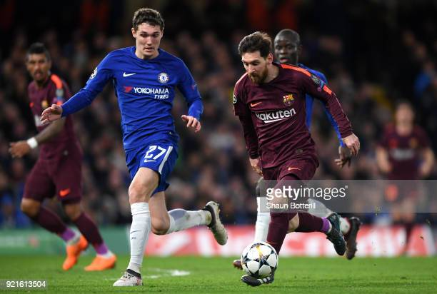 Lionel Messi of Barcelona runs with the ball under pressure from Andreas Christensen of Chelsea during the UEFA Champions League Round of 16 First...