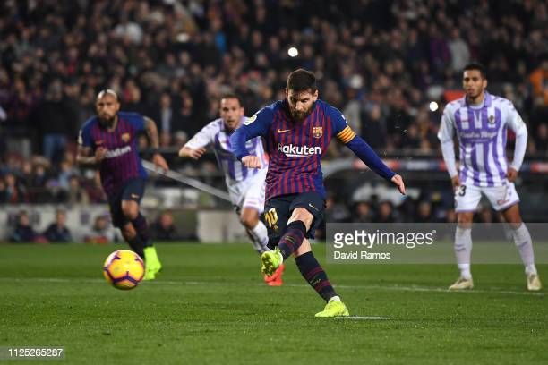 Lionel Messi of Barcelona scores a penalty for his team's first goal during the La Liga match between FC Barcelona and Real Valladolid CF at Camp Nou...
