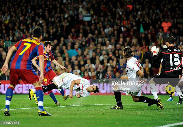 Lionel Messi of Barcelona scores his first goal during the La Liga match between Barcelona and Sevilla FC on October 30 2010 in Barcelona Spain...