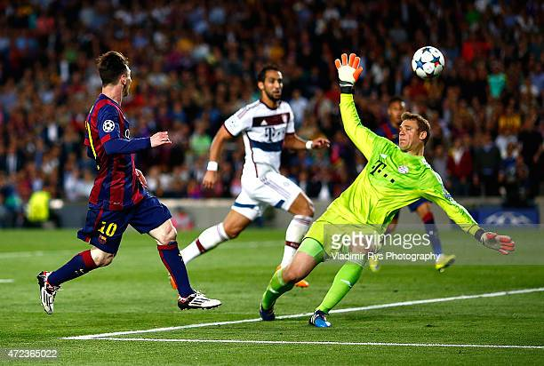 Lionel Messi of Barcelona scores his second goal against Manuel Neuer of Bayern during the first leg of UEFA Champions League semifinal match between...