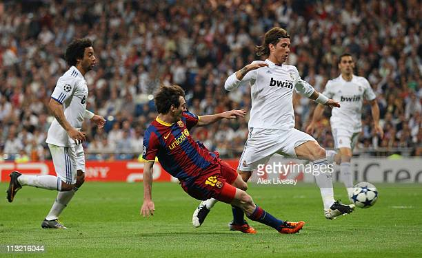 Lionel Messi of Barcelona scores his second goal during the UEFA Champions League Semi Final first leg match between Real Madrid and Barcelona at...