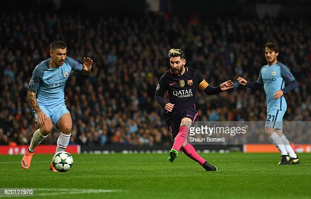 Lionel Messi of Barcelona scores his sides first goal during the UEFA Champions League Group C match between Manchester City FC and FC Barcelona at...