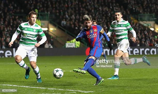 Lionel Messi of Barcelona scores his sides first goal during the UEFA Champions League Group C match between Celtic FC and FC Barcelona at Celtic...