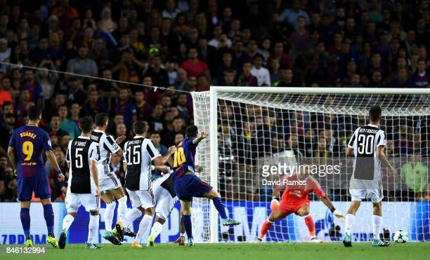 Lionel Messi of Barcelona scores his sides first goal during the UEFA Champions League Group D match between FC Barcelona and Juventus at Camp Nou on...