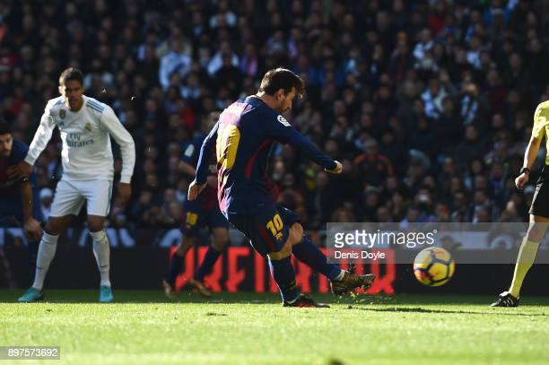 Lionel Messi of Barcelona scores his sides second goal from the penalty spot during the La Liga match between Real Madrid and Barcelona at Estadio...