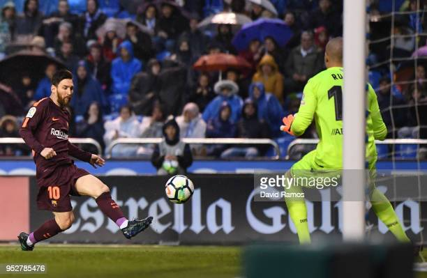 Lionel Messi of Barcelona scores his sides second goal past Ruben of Deportivo La Coruna during the La Liga match between Deportivo La Coruna and...