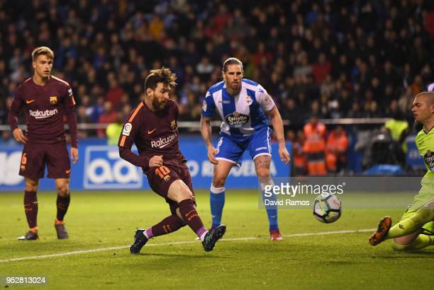 Lionel Messi of Barcelona scores his sides third goal past Ruben of Deportivo La Coruna during the La Liga match between Deportivo La Coruna and...