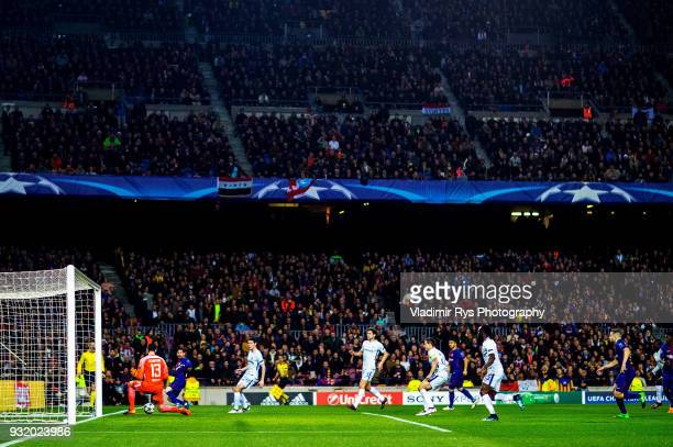 Lionel Messi of Barcelona scores his team's first goal against Thibaut Courtois of Chelsea during the UEFA Champions League Round of 16 second leg...