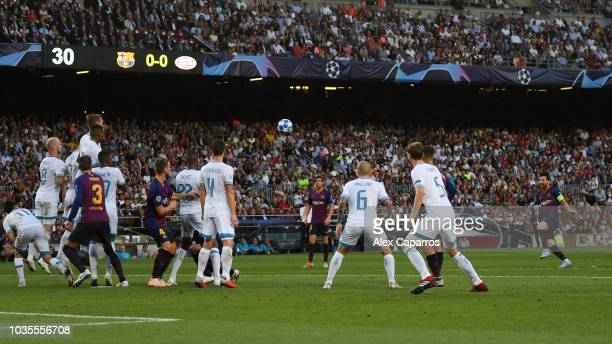 Lionel Messi of Barcelona scores his team's first goal during the Group B match of the UEFA Champions League between FC Barcelona and PSV at Camp Nou...
