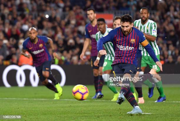 Lionel Messi of Barcelona scores his team's first goal during the La Liga match between FC Barcelona and Real Betis Balompie at Camp Nou on November...