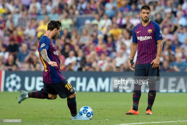 Lionel Messi of Barcelona scores his team`s first goal during the UEFA Champions League Group B match between FC Barcelona and PSV at Camp Nou on...