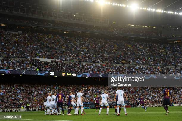 Lionel Messi of Barcelona scores his team's first goal from a free kick during the Group B match of the UEFA Champions League between FC Barcelona...