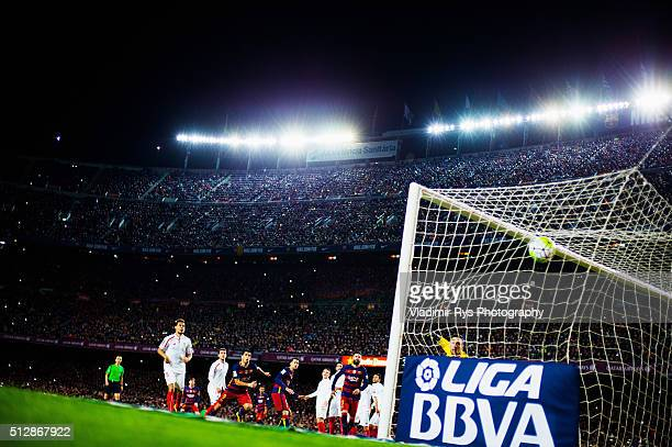 Lionel Messi of Barcelona scores his team's first goal from a free kick while goal keeper Sergio Rico of Sevilla looks on during the La Liga match...