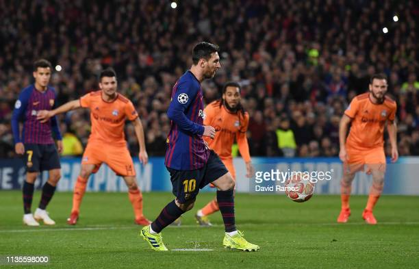 Lionel Messi of Barcelona scores his team's first goal from a penalty during the UEFA Champions League Round of 16 Second Leg match between FC...