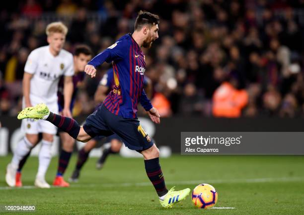 Lionel Messi of Barcelona scores his team's first goal from the penalty spot during the La Liga match between FC Barcelona and Valencia CF at Camp...
