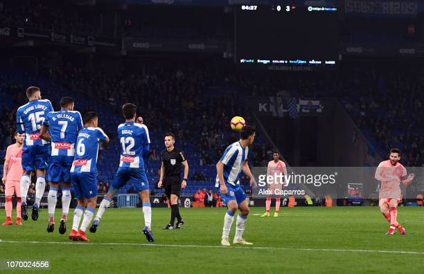 Lionel Messi of Barcelona scores his team's fourth goal during the La Liga match between RCD Espanyol and FC Barcelona at RCDE Stadium on December 8...