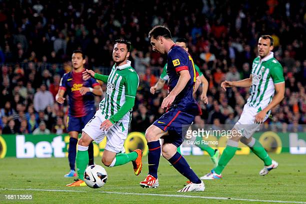 Lionel Messi of Barcelona scores his team's fourth goal during the La Liga match between FC Barcelona and Real Betis Balompie at Camp Nou on May 5...