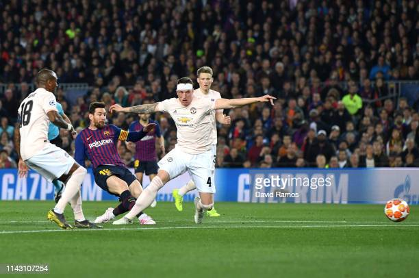 Lionel Messi of Barcelona scores his team's second goal as Phil Jones of Manchester United tries to challenge during the UEFA Champions League...