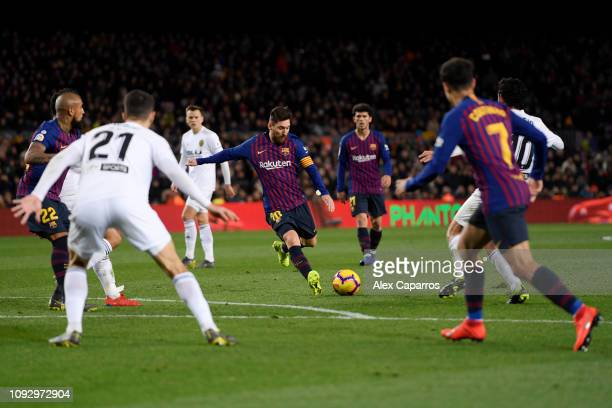 Lionel Messi of Barcelona scores his team's second goal during the La Liga match between FC Barcelona and Valencia CF at Camp Nou on February 2 2019...