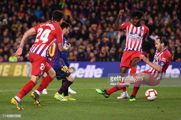 Lionel Messi of Barcelona scores his team's second goal during the La Liga match between FC Barcelona and Club Atletico de Madrid at Camp Nou on...