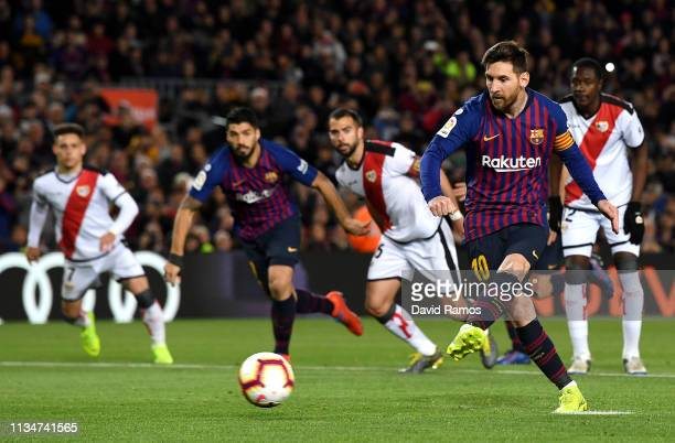 Lionel Messi of Barcelona scores his team's second goal from the penalty spot during the La Liga match between FC Barcelona and Rayo Vallecano de...
