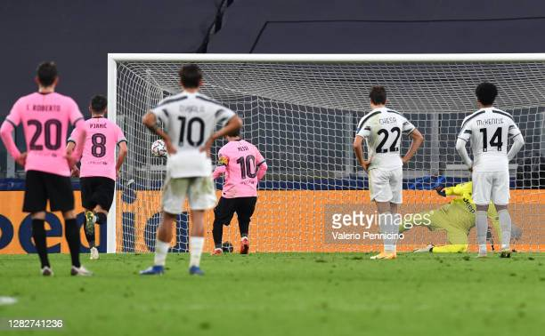 Lionel Messi of Barcelona scores his team's second goal from the penalty spot during the UEFA Champions League Group G stage match between Juventus...