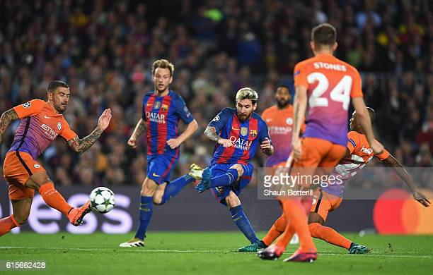 Lionel Messi of Barcelona scores his teams second goal of the game during the UEFA Champions League group C match between FC Barcelona and Manchester...