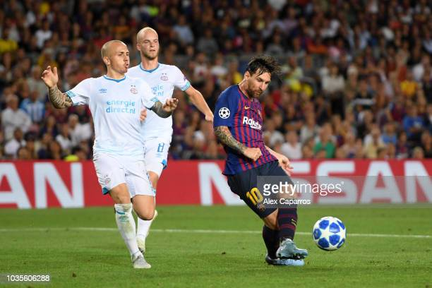 Lionel Messi of Barcelona scores his team's third goal during the Group B match of the UEFA Champions League between FC Barcelona and PSV at Camp Nou...