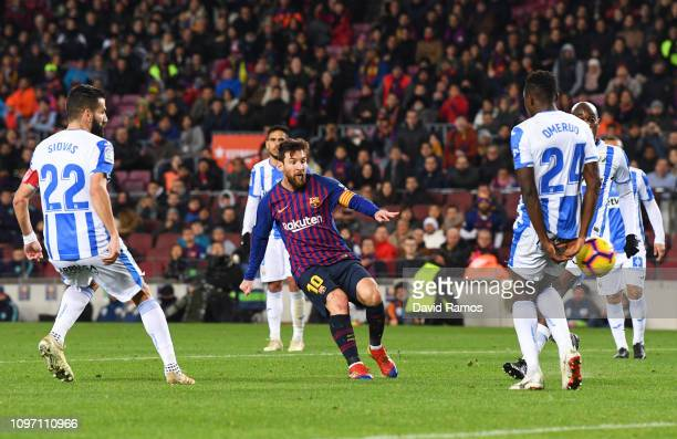 Lionel Messi of Barcelona scores his team's third goal during the La Liga match between FC Barcelona and CD Leganes at Camp Nou on January 20 2019 in...