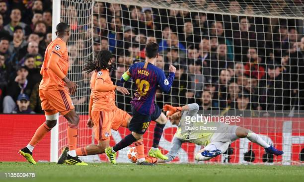 Lionel Messi of Barcelona scores his team's third goal past Mathieu Gorgelin of Olympique Lyonnais during the UEFA Champions League Round of 16...