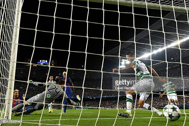 Lionel Messi of Barcelona scores his third and his sides fifth goal during the UEFA Champions League Group C match between FC Barcelona and Celtic FC...